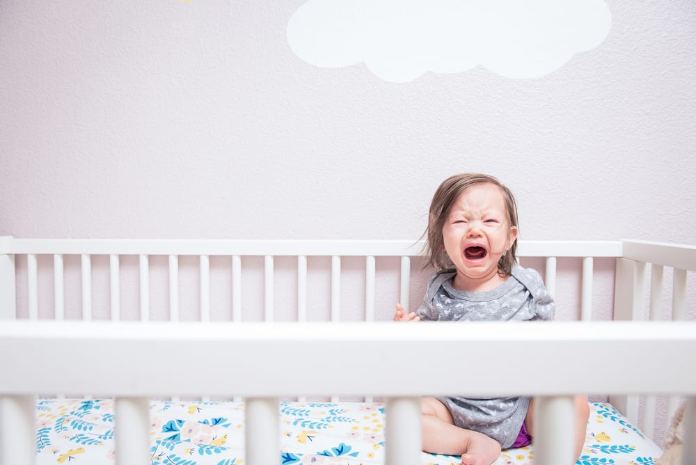 Baby crying in her crib