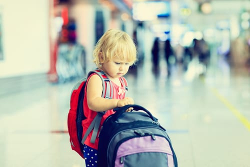 Child with bookbag on a plane